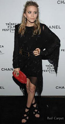 Mary-Kate Olsen wearing an asymmetrical dress