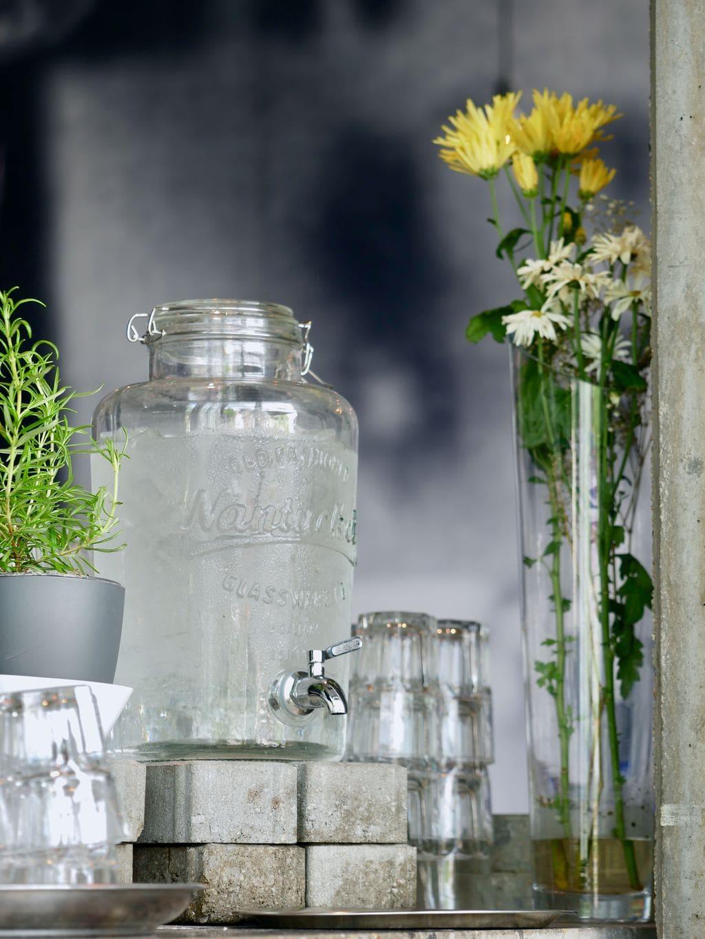Mason jar pitcher full of water