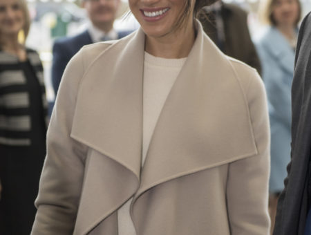 Meghan Markle wearing a nude coat and beige dress