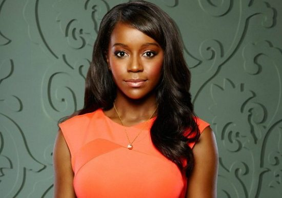 Michaela Pratt from How to Get Away with Murder in a coral dress