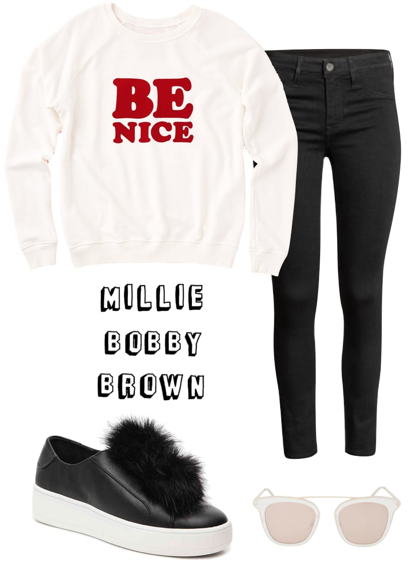Millie Bobby Brown Outfit: Be Nice graphic sweatshirt, cropped black skinny jeans, platform slip on sneakers with fur accent, brow bar sunglasses