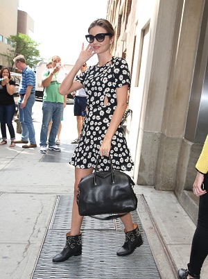 Miranda Kerr in a daisy print dress and black motorcycle boots