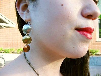 Mixed metal earrings at webster university