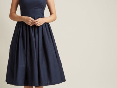 Navy blue fit-and-flare sleeveless midi dress with side slit pockets