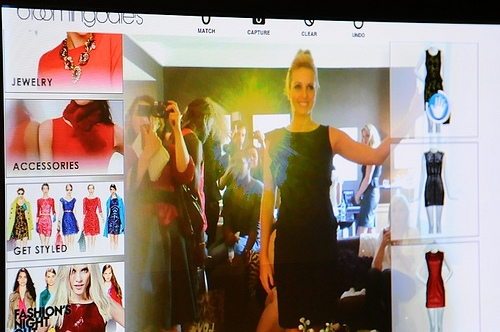 Model demonstrating the Facecake Swivel virtual fitting room at the Style Coalition lounge