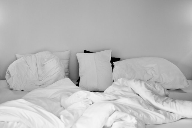 Bed with pillows and blanket