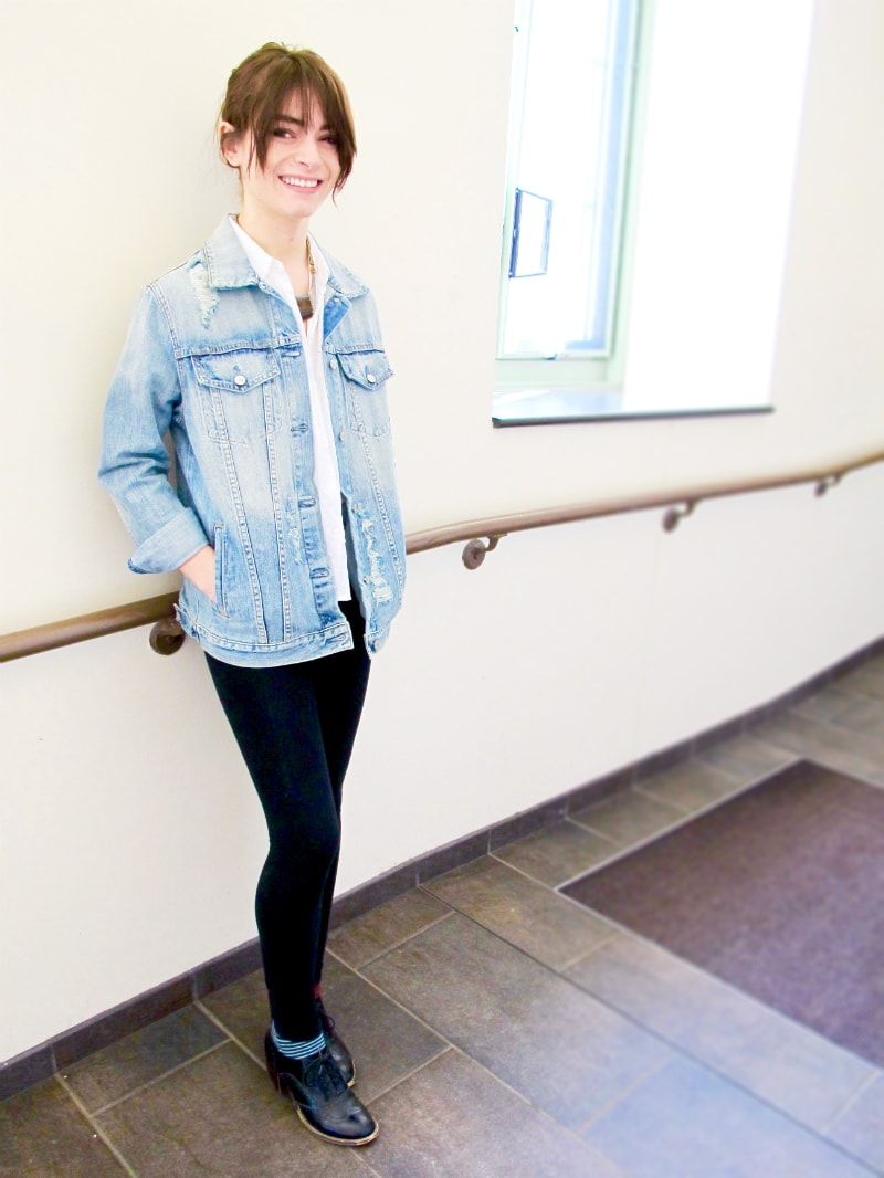 Campus fashion at MSU - student Grace wears a distressed jean jacket, white button-down shirt, leggings, and oxfords
