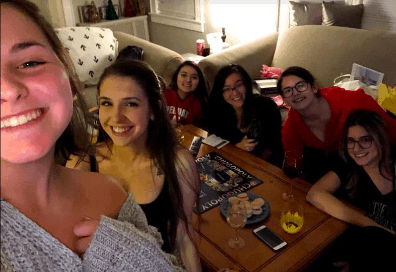 Roommates enjoying a fun board game night