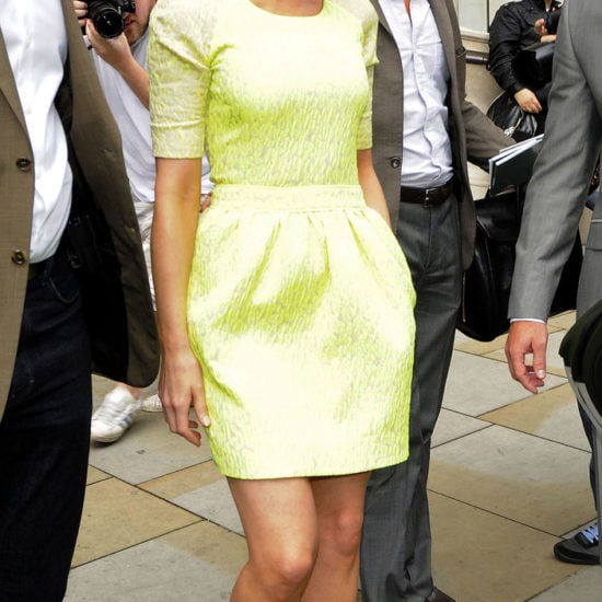 Kate Beckinsale wears a neon dress