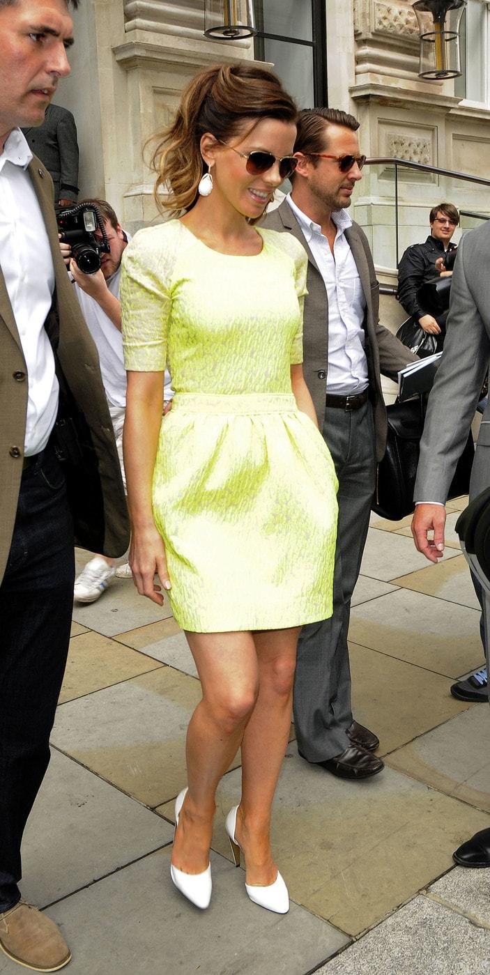 Kate Beckinsale wears a neon dress