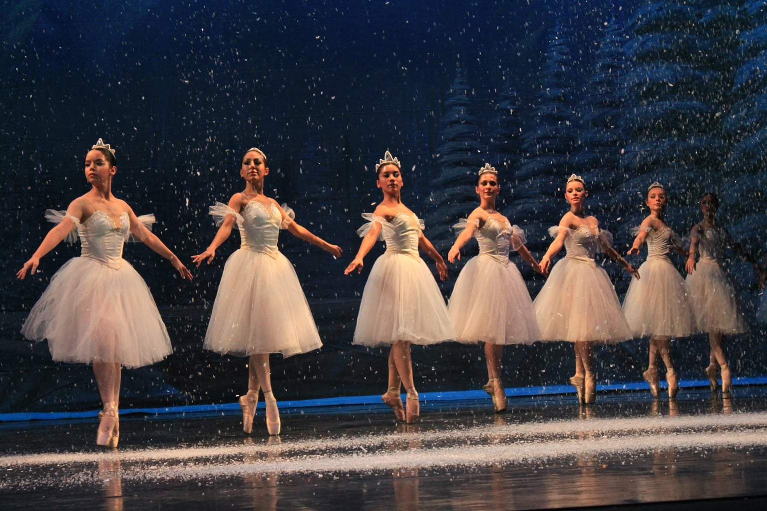 The Snowflakes dancing during the Nutcracker Ballet, with fake snow falling on them