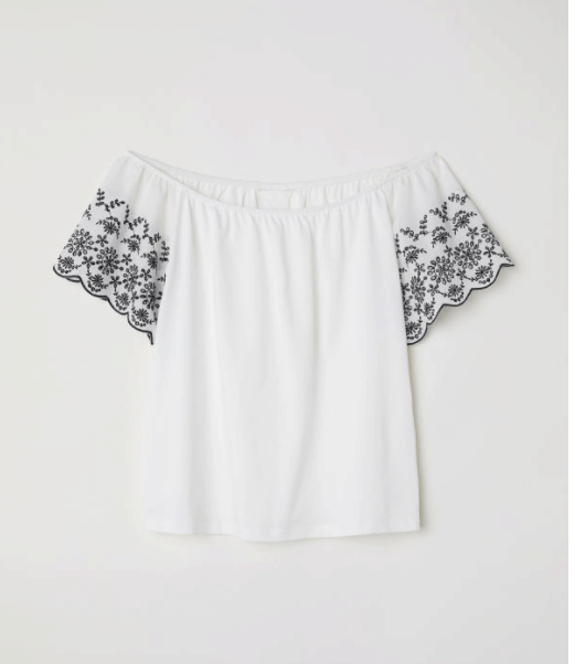 white off the shoulder shirt with embroidery
