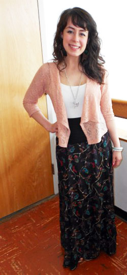 College student fashionista at Oregon State University wearing trends like a maxi skirt, lace cardigan, and pendant necklace