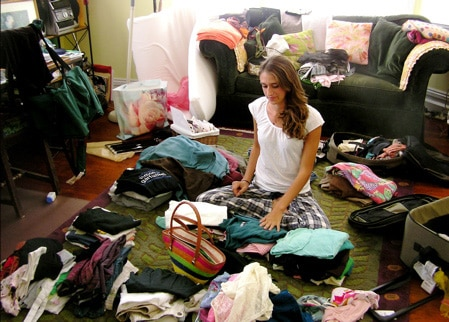 Girl organizing her clothes