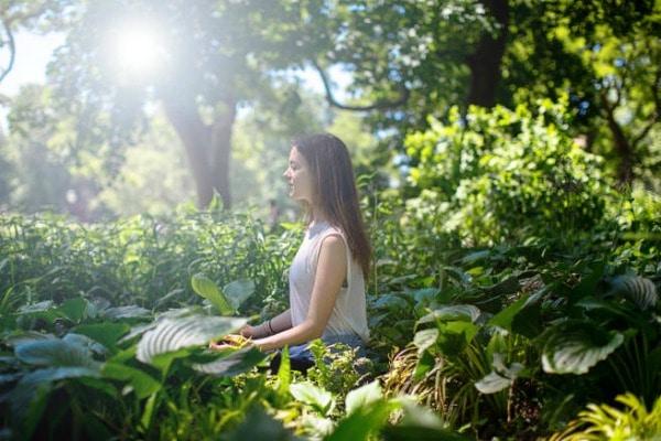 Outdoor woman meditating
