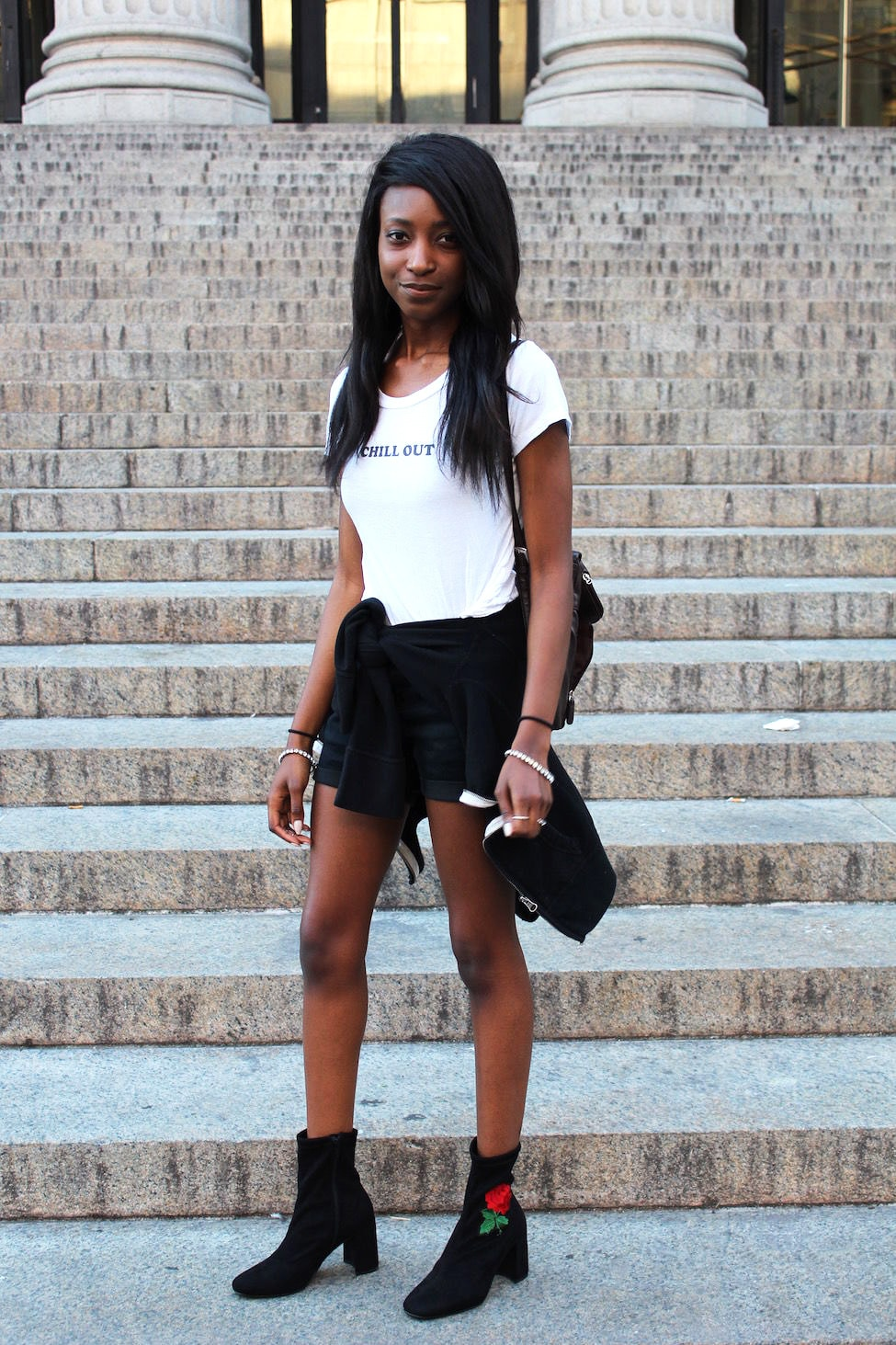 Outfits for College: Street style example. College student from University of Missouri wears a Chill Out graphic tee shirt, rose embroidered booties, black shorts, and a black mini backpack