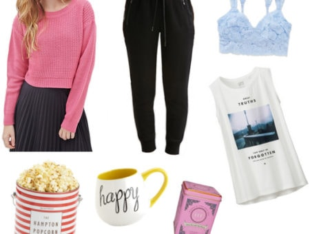Pink cropped sweater, black joggers, blue bralette, graphic tank, popcorn, mug, and tea