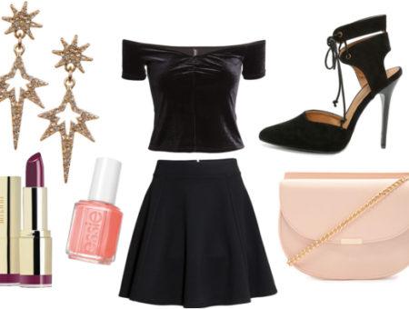 Starburst earrings with lipstick, pink nail polish, black velvet top, black skirt, heels, and pink crossbody