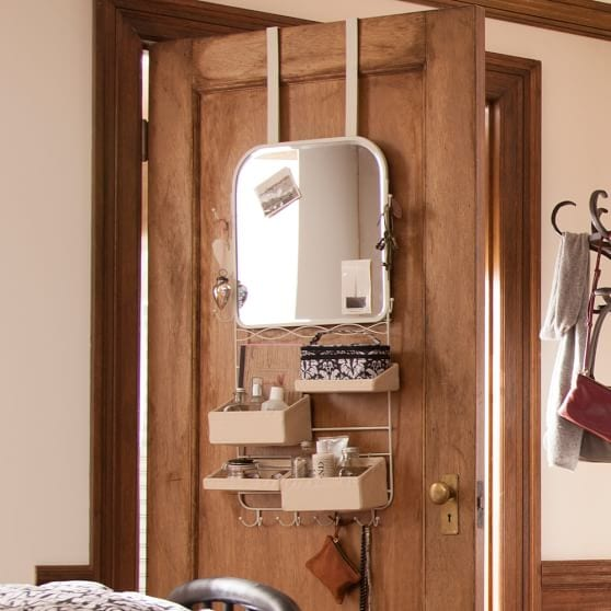 Hanging over the door mirror rack with cubbies and hooks.