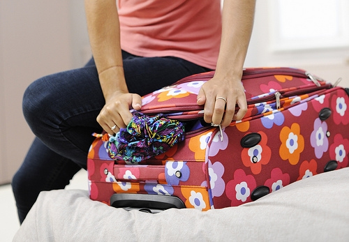 Girl packing a suitcase