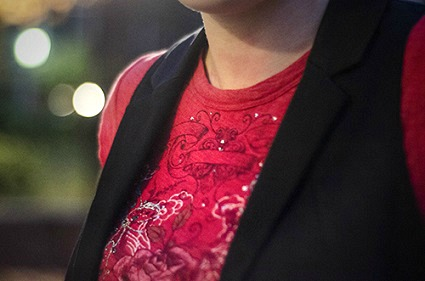 Pairing a graphic tee with a vest