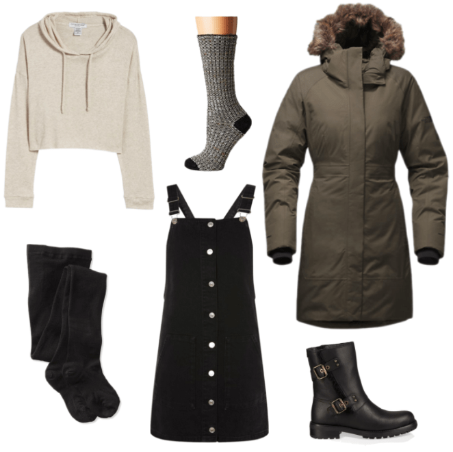 How to wear a parka and still look stylish: Outfit with long brown parka with fur hood, black overall dress, cropped hoodie, wool socks, black fleece lined tights, chunky ankle boots