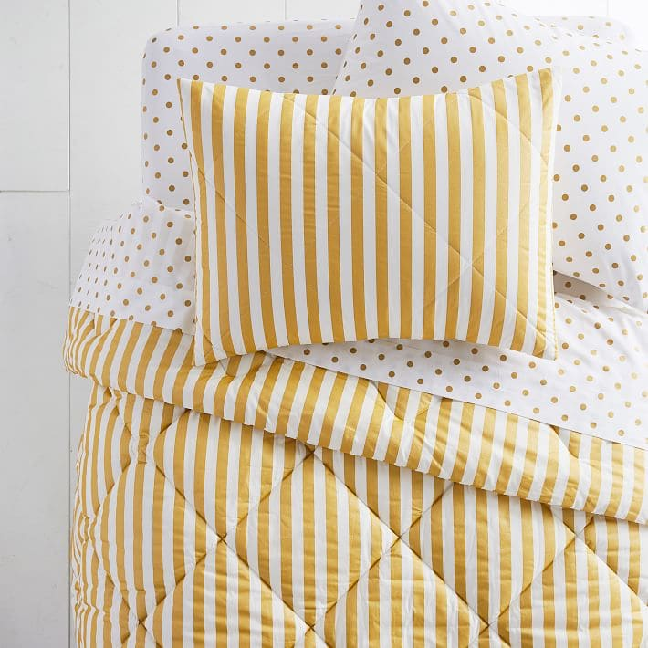 Bold yellow and white striped comforter and polka dot sham set from PB Teen.