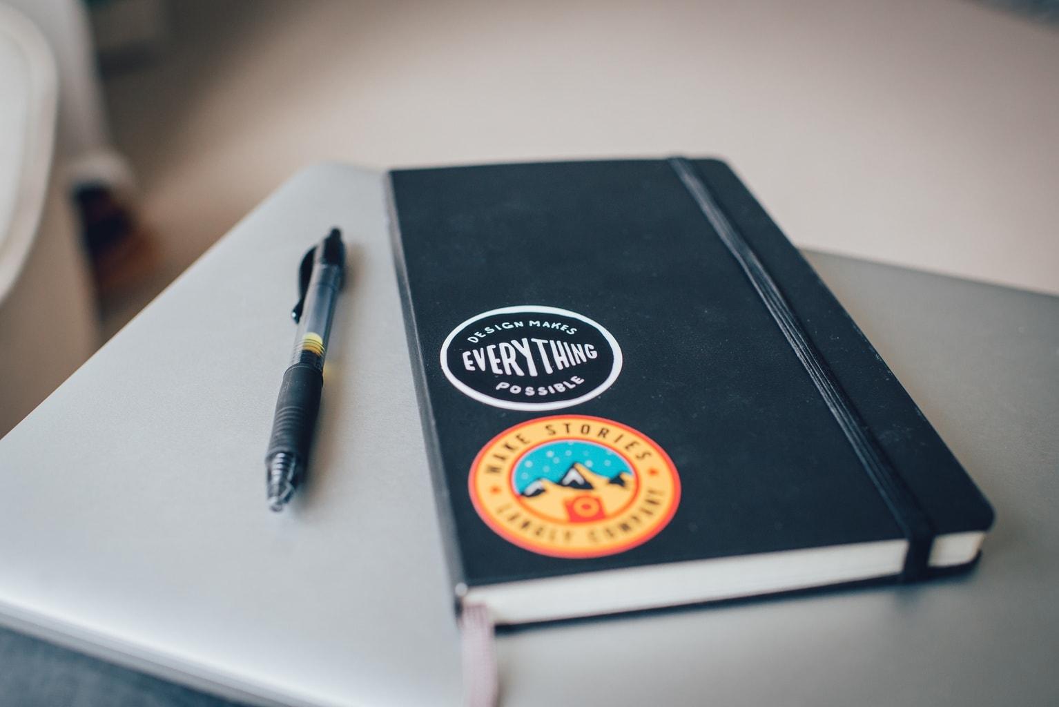 black pen and black journal/planner