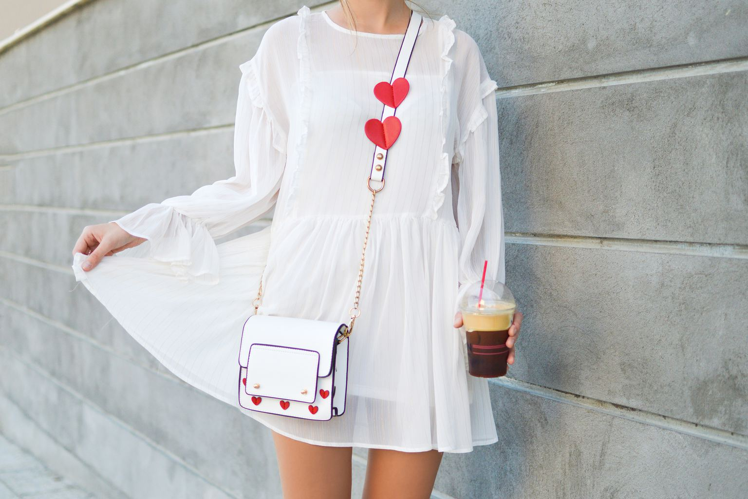 Girl wearing crossbody bag with hearts