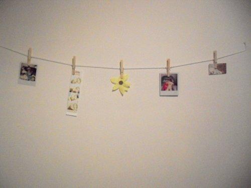 Polaroid photos on a clothesline