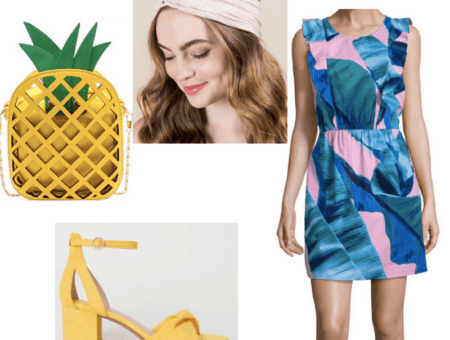 An outfit spread featuring a yellow pineapple-shaped purse, pink dress with blue-green leaves on it, yellow heeled sandals, and pink wrap headband.