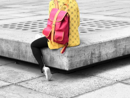 Student with a pink backpack