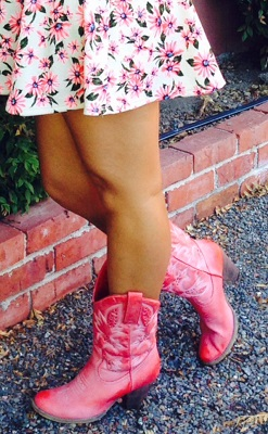 Pink cowgirl boots and floral skirt