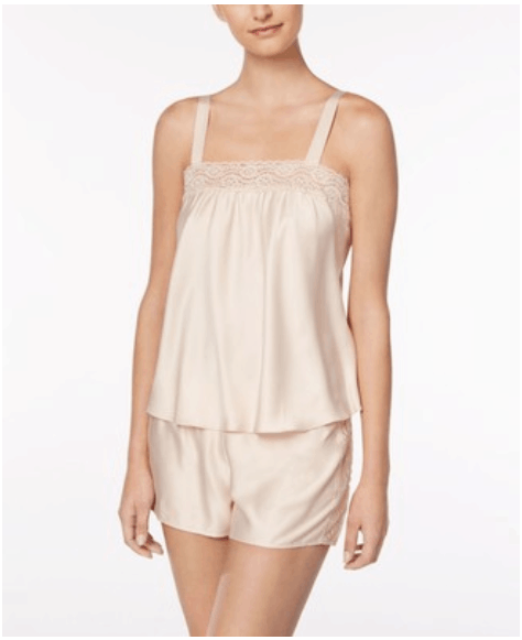 Pale pink silky camisole-and-shorts pajama set with lace trim at neckline