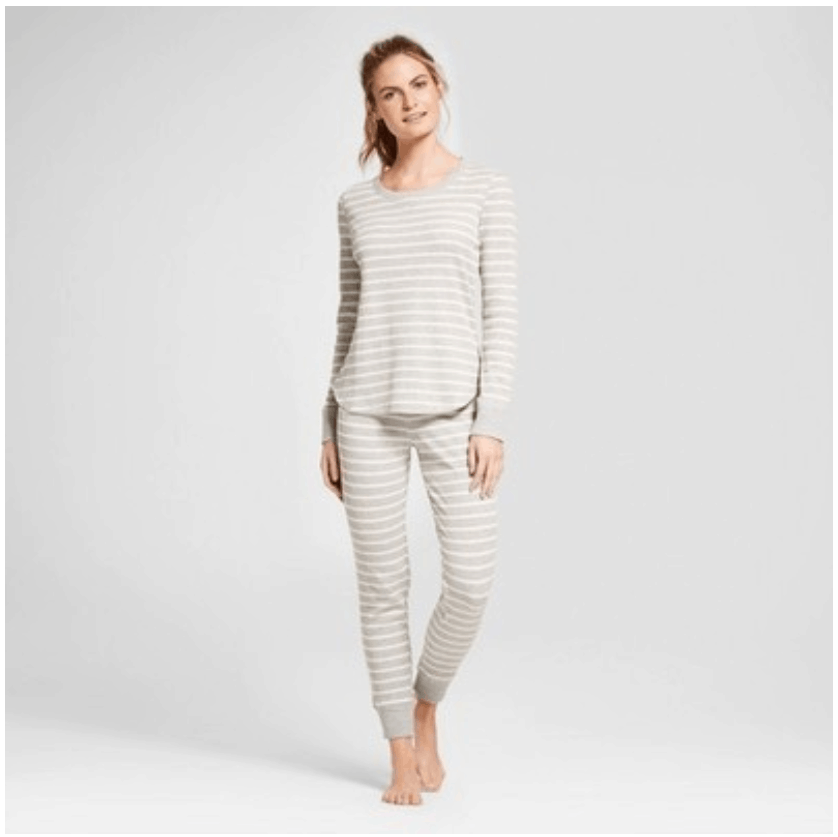Gray pajama set with white skinny horizontal stripes, and long-sleeved top and long skinny bottoms with cuffs at wrists and ankles