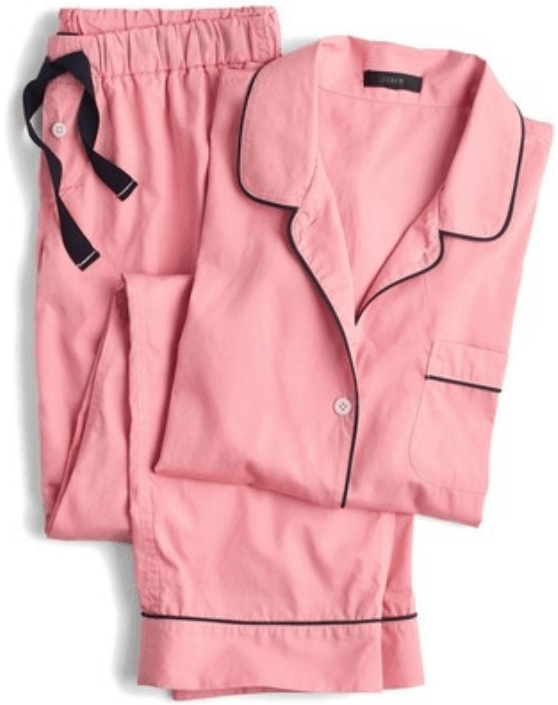Bright pink pajama set with black piping, and long-sleeved top with chest pocket and long bottoms with black drawstrings and buttons at waist
