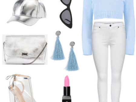 metallic pom pom cap with light blue crop sweater, white denim jeans, light blue earrings, pink lipstick, black cat eye sunglasses, metallic purse, and clear open toe heels.