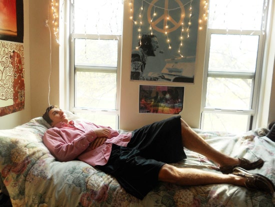 Andy in his preppy dorm room