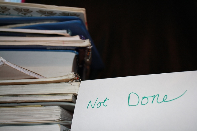 stack of notebooks and not done sign