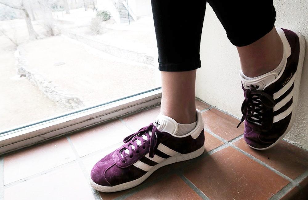 Purple adidas sneakers on campus at Kansas State University