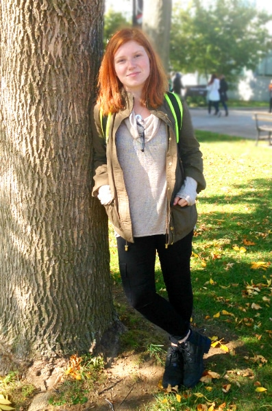 College street style at Queens College in NYC - Military jacket, black jeans, sweater, booties, utilitarian backpack