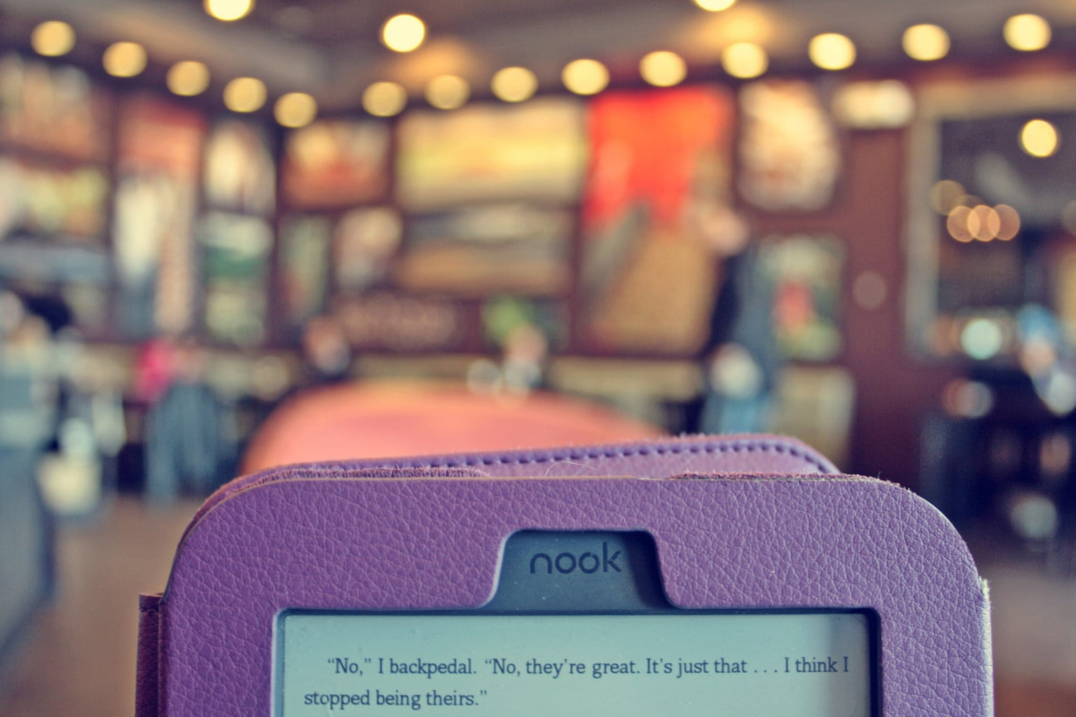 Purple nook tablet reader with a book opened on the screen