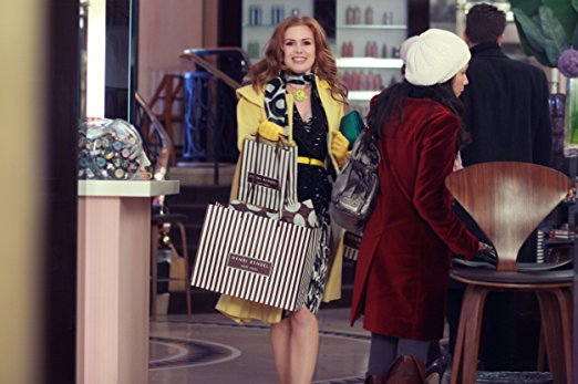 Confessions of a Shopaholic tips: Rebecca Bloomwood carrying shopping bags from Bendel's