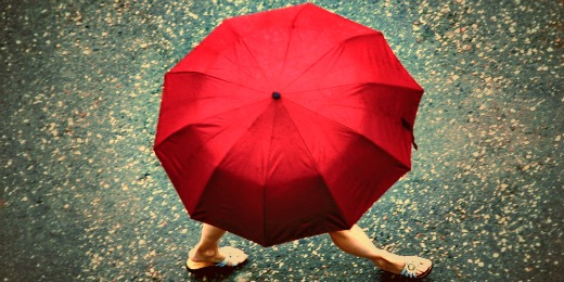 Girl carrying red umbrella