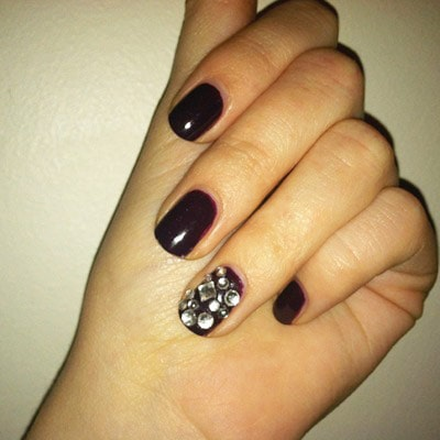 Rhinestones on burgundy nail polish