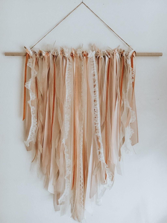 Photo of a ribbon wall hanging.