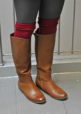 Riding boots worn with tights and socks