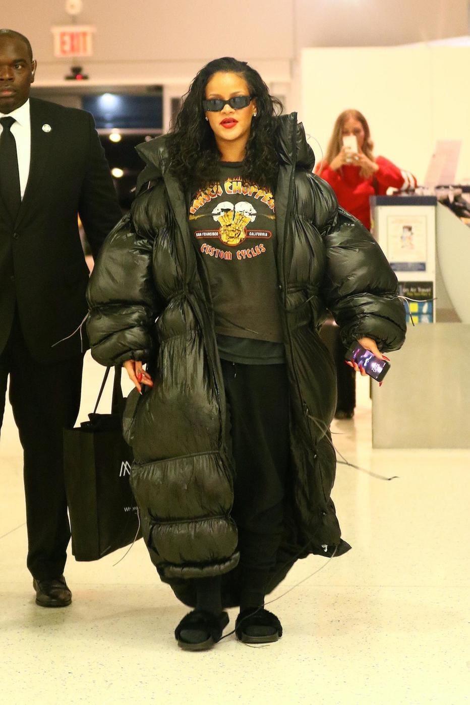 Rihanna in an oversized full-length jacket.
