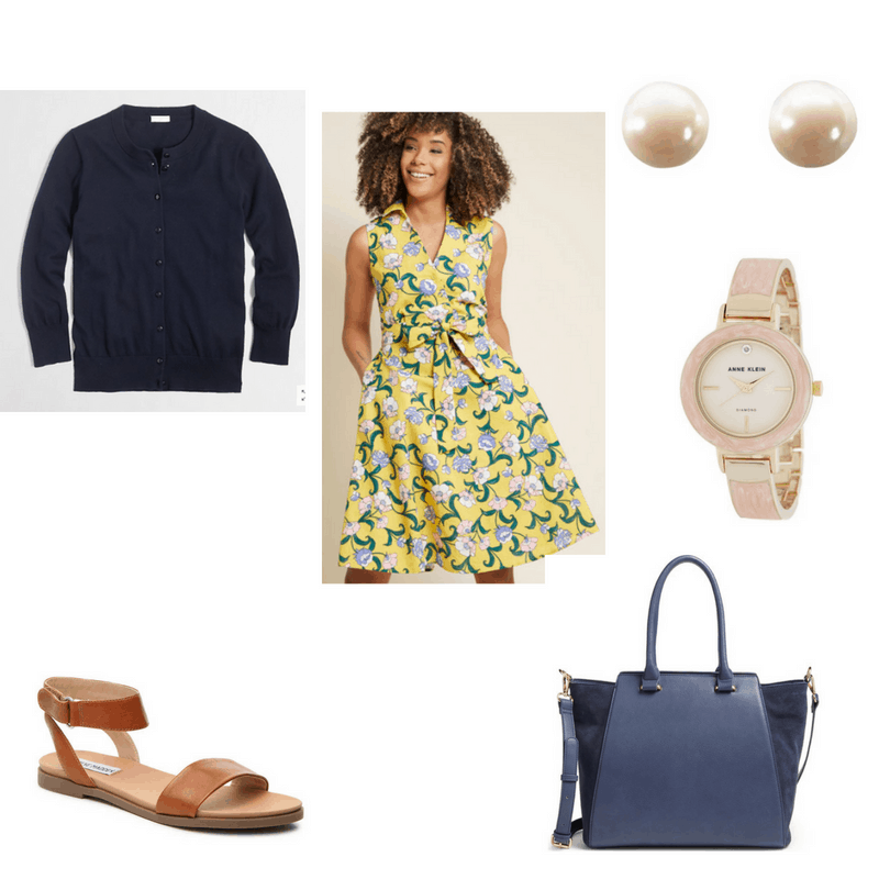 Summer work outfit with floral yellow shirtdress, navy cardigan, brown sandals, pearl earrings, watch, and navy satchel