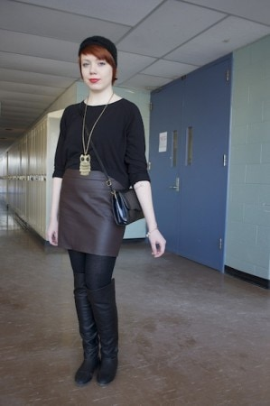 High waisted leather skirt and black crop top on a college fashionista